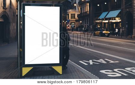 Blank advertising light box on bus stop mockup of empty ad billboard on night bus station template banner on background city street for poster or sign in Barcelona afisha board and headlights of taxi cars