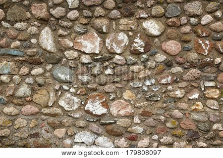 Backgrounds of stone wall. Rock wall seamless texture