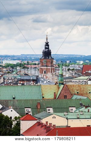 Beautiful high gothic town hall tower with clock in the main Market Square in Cracow, Poland. Travel Europe. Aerial view. Panorama of city