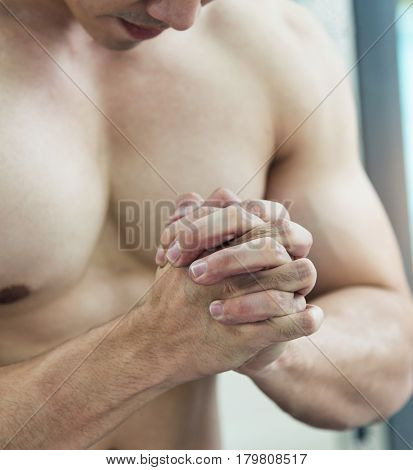 Stressed concept of Asian Muscular man. Close up of Male fists.