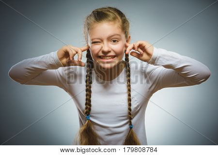 Closeup portrait of worried girl covering her ears, observing. Hear nothing. Human emotions, facial expressions.