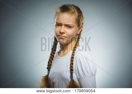 Portrait of offense girl. Negative human emotion.