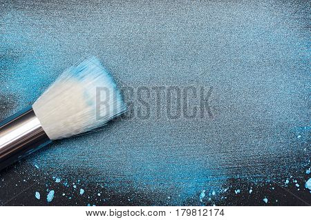 Artistic Brush on smudged Make-up Product Particles