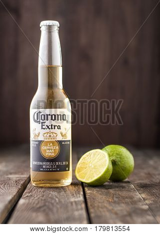 Editorial Photo Of Bottle Of Corona Extra Beer With Lime On Dark Wooden Background