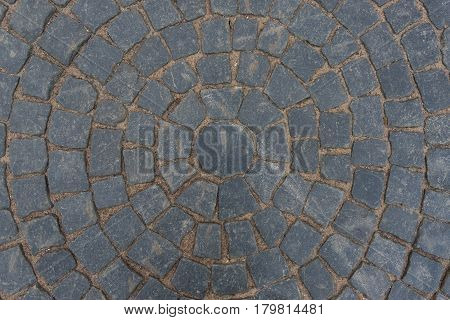 Gray paving stone paved with a pattern circule