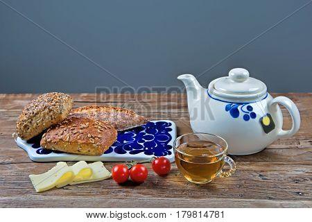 Studio shot of rolls and tea on a breakfast table