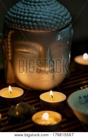 Buddha and candles Chinese tea ceremony. Vertical orientation