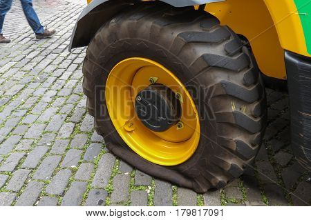 EDINBURGH UK - CIRCA AUGUST 2015: road work truck with a punctured tyre