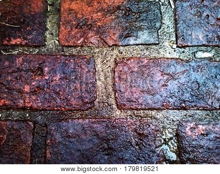 Wet bricks floor. Soaked floor made with bricks