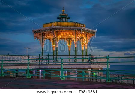 Brighton bandstand at sunset against blue sky