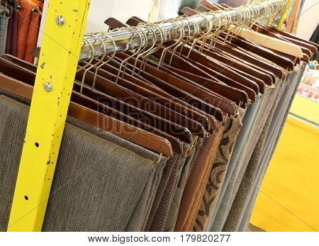 clothes hanging for sale in fashion store