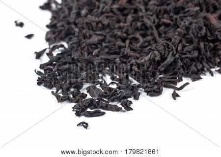 Dry Black Tea Leaves Isolated On White Background