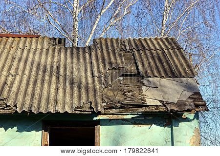 Old slate roof in an abandoned house