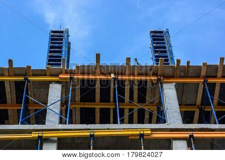 Close up of construction site of new concrete building with scaffoldings