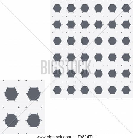 Abstract seamless geometric pattern of light and dark gray hexagons.