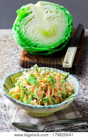 Cabbage salad cole slaw in a ceramic bowl. style rustic. selective focus