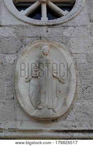 PRIMOSTEN, CROATIA - SEPTEMBER 10, 2016: This is the relief of the Virgin on the walls of the newly built church of St. George.