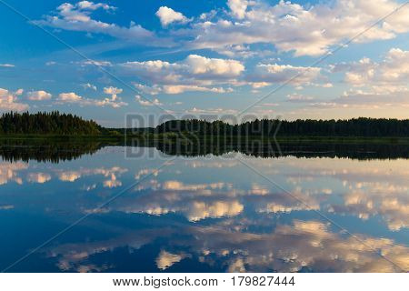 Cloudy sky reflected in the smooth surface of the river