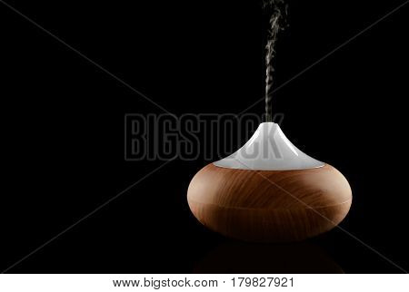 Aroma oil diffuser on black background