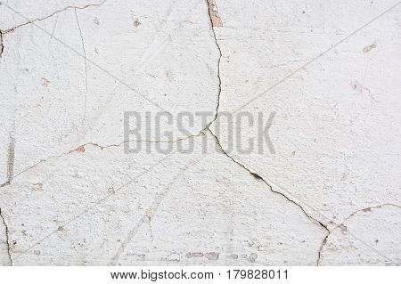 Abstract texture of wall covered with obsolete cracked cement plaster