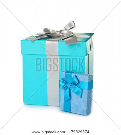 Set of beautiful gift boxes with wonderful bows of shiny ribbons on white background