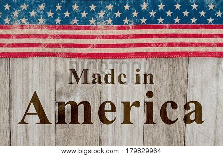 Made in America message USA patriotic old flag and weathered wood background with text Made in America