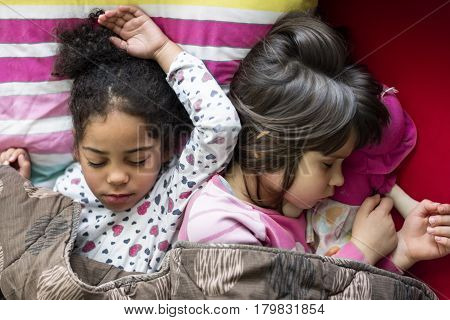 two girls sleeping together, multi racial friendship