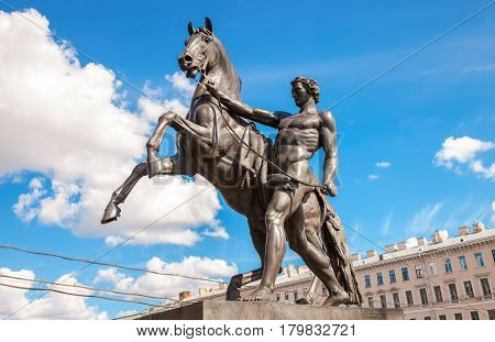 Sculpture tamer of horses designed by the Russian sculptor Baron Peter Klodt. Anichkov bridge St. Petersburg Russia 1841