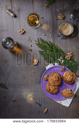 Homemade walnut cookies on dark old wooden table, white wine. Freshly baked coconut cookies on rustic background. Copy space, top view.