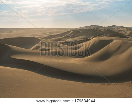Huacachina desert dunes in Ica Region, Peru, during a sunny and hot afternoon.