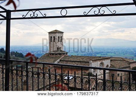 Building seen through fence in Assisi, Italy