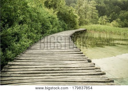Wooden pathways lead visitors through forests and over lakes at Plitvice Lakes National Park in Croatia. This is one of the first walkways when you get off the train at the upper lakes.