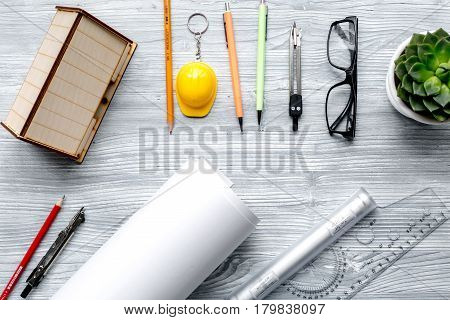 Construction office with architect working tools and glasses on light wooden table background top view