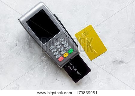 payment terminal and credit card in purchasing concept on stone table background top view