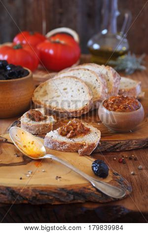 Mediterranean sauce and ingredients: tomatoes black olives and olive oil appetizer