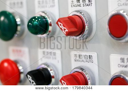 Switches and buttons on control panel of industrial equipment. Selective focus.