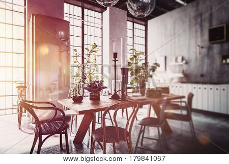 Dining room table and chairs in spacious modern home with tall windows and sun flare. 3d Rendering