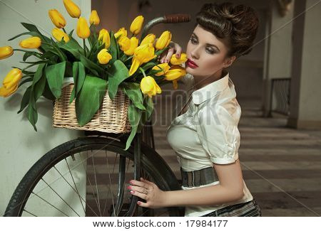 Beauty brunette with bunch of flowers