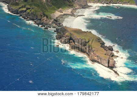 Aerial view of Forbidden Island, Saipan Surrounded by blue skies and pristine blue waters, the Forbidden Island is one popular tourist attraction in Saipan, Northern Mariana Islands.