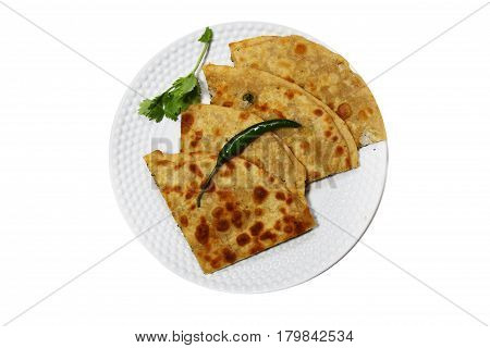 Healthy Indian Mooli or Radish paratha or stuffed flatbread with coriander and green chilies on white background