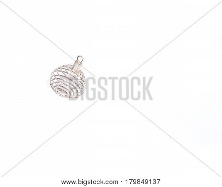 Tarnish-free spiral cage for stones and crystals isolated on white background