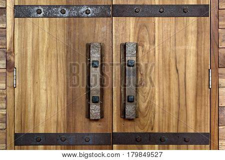 old antique door handle and door lock on wooden door