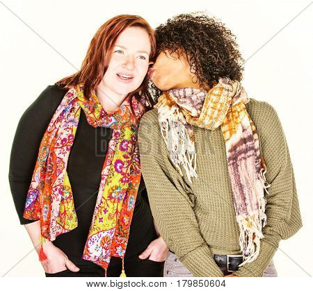 Woman Whispering To Friend At Ear