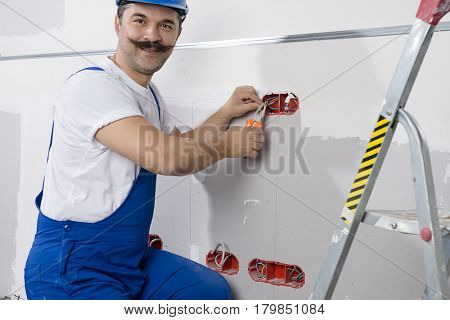 Manual Worker Installing Power Socket