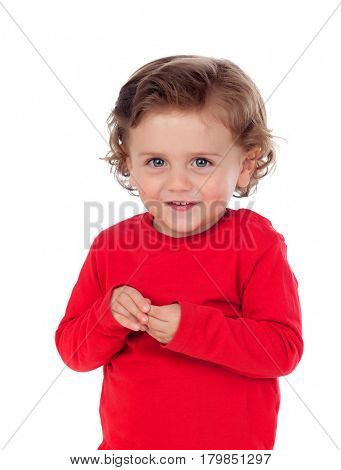 Beautiful little child two years old with red jersey smiling isolated on a white background