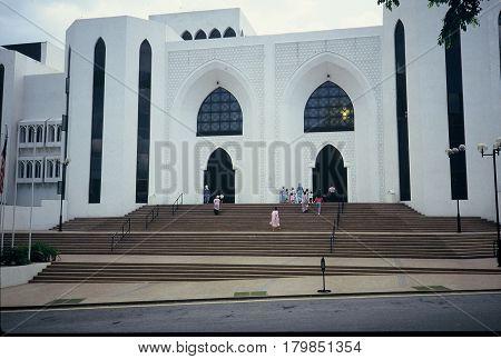 Worshippers enter the National Mosque of Malaysia (Masjid Negara Malaysia) in Kuala Lumpur.