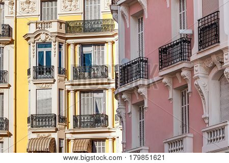 Colorful ornate residential building in Menton - small town on French Riviera.