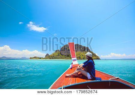 Happy female traveling on boat Krabi Thailand