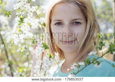 Natural woman portrait with blooming tree