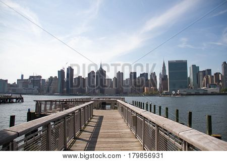 Pier at Gantry Plaza State Park and Manhattan city, New York